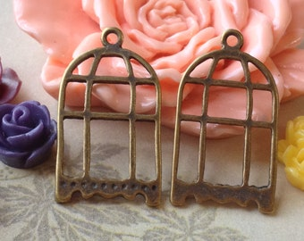 15 mm x 21 mm Antique Bronze Bird Cage Charms (.sm)