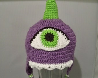 One Eyed One Horn Flying  Purple People Eater with Ear Flaps and Tassels