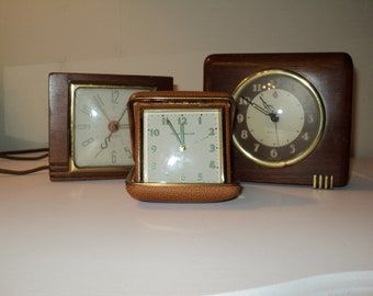 Vintage Alarm Clock Collection consisting 3 various time pieces for display on a book shelf or on a night stand, instant collection