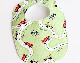 newborn bib.  cars and racetrack.  baby boy.