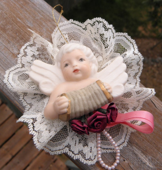 Victorian Porcelain Cherub with Accordian Ornament with Beautiful Face Artist Hand Painted