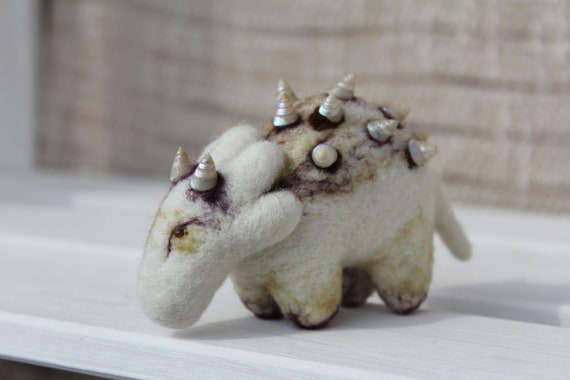 Collector of marine snails, needle felted creature