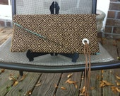 Brown and tan clutch bag with leather tassel, envelope clutch.