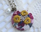 03 Hand embroidered pendant: mustard flowers on multi-colored background