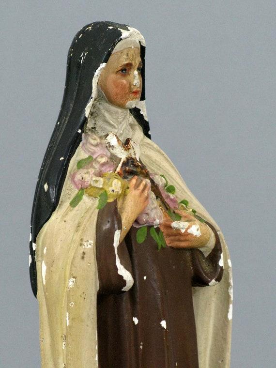 a statue of  Saint Theresa  (Sainte Therese)