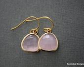 001- Gold framed pink rose quartz color stone earrings