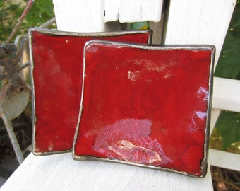 Two Red Ceramic Dishes