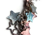 Metal Stars Bookmark: small silver tone metal bookmark with star charms and pink and turquoise shell star beads.