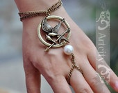 The Hunger Games pendant Mockingjay Arrow and Peeta pearl bracelet and ring --Bronze Brass