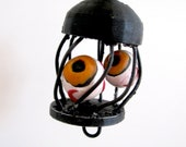 Three Orange Eyeballs in a Wire Cage Halloween Pendant