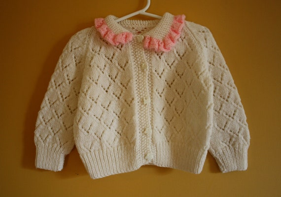 Vintage handknit pointelle cardigan sweater, pink ruffles / bunny buttons  / Size 18 to 24 months
