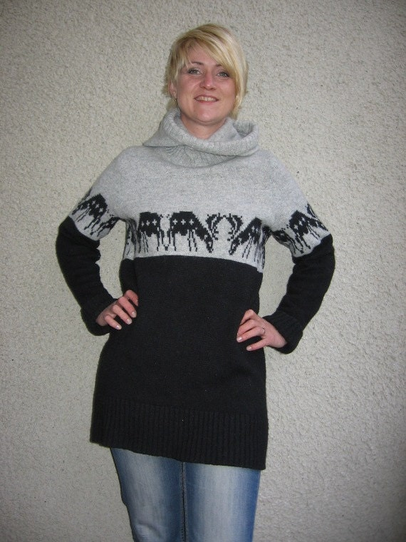 Knitted wool sweater with a hood