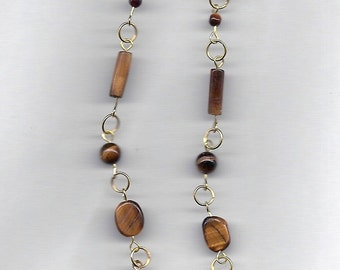 "Tiger Eye beads of various sizes team up with gold filled findings in these 4"" drop earrings."