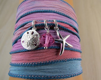 Silk Wrap bracelet with a sand dollar and a starfish in sterling silver and a Swarovski Crystal