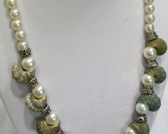 Shell and pearl necklace.