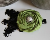 Green flower rosette  with black feathers hair clip