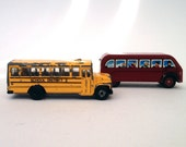 Two toy metal buses: Thomas the Tank Engine bus and an American school bus, 1980s