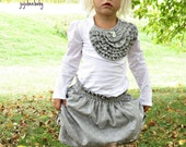 White shirt with bib of grey pleated ruffles long sleeve knit