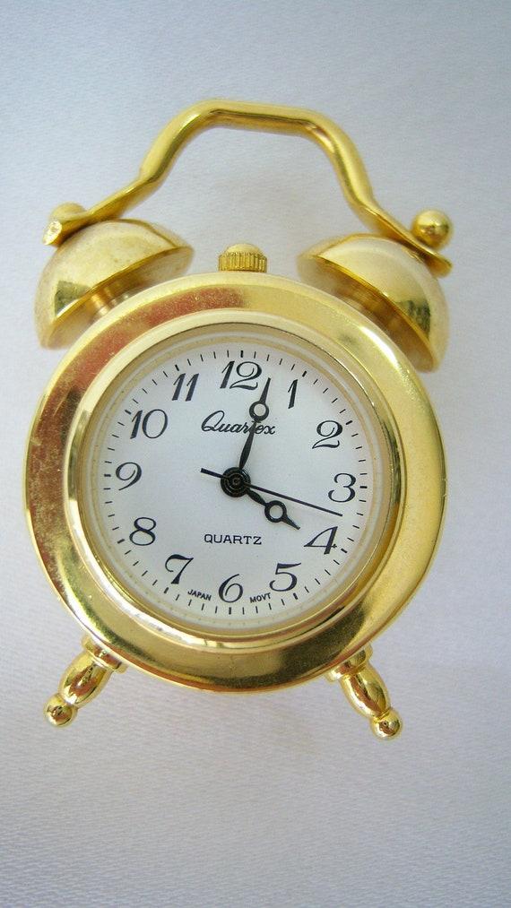 small brass quartz alarm clock with battery
