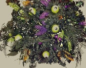 Halloween wreath or table top centerpiece.  Eyes all over U