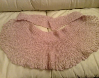 Hand knitted pinkish mini shawl with slight metallic accent.
