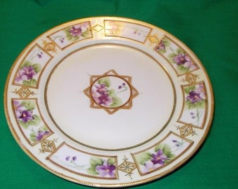 "One (1), 8 1/2"" Nippon Porcelain, Moriage Decorated Plate from Morimura Bros. (Noritake), in a Violet Pattern."