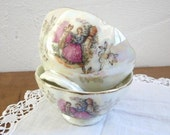 2 Mini PORCELAIN BOWLS,  little bowls with a romantic scene, silver flowers and scalopped edges.