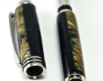 Hand turned Wooden Pen Handcrafted from Buckeye Burl Cast in Blue Fleck Acrylic Rhodium Hardware 329Q