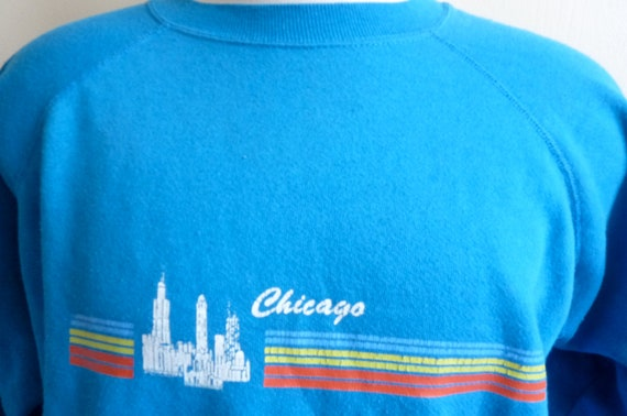 vintage 80's Chigaco skyline with horizontal rainbow stripe distressed printing teal super soft fleece sweatshirt