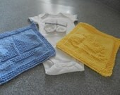 Baby boy onsie, socks with hand crochet trim and hand knitted wash cloths