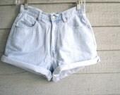 vintage denim shorts in stripe & solid mix. high waisted light wash five pocket jean shorts. size medium.