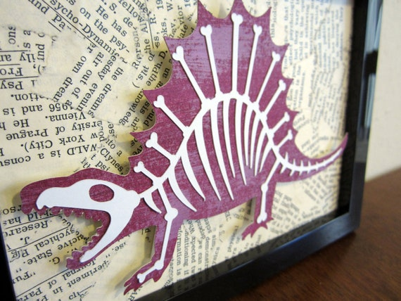 Dinobones - Dinosaur with Bones, Book Page Collage Background - Cut Paper Framed Wall Art - Purple, White with Black Frame