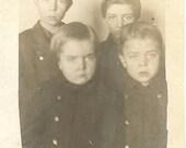 Antique Photograph of 4 Unhappy Boys