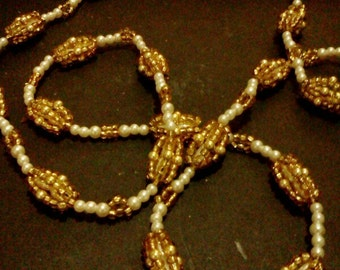 Golden cage seed bead necklace