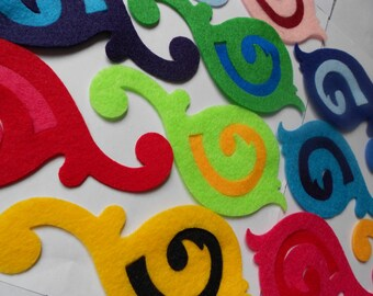 14 treble clef felt flourishes die cut pieces- mix and match outside and inside pieces.  Perfect for applique, quilting, stitch witchery.