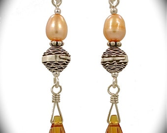 Intricately designed Bali bead with Swarovski crystals- new earring collection