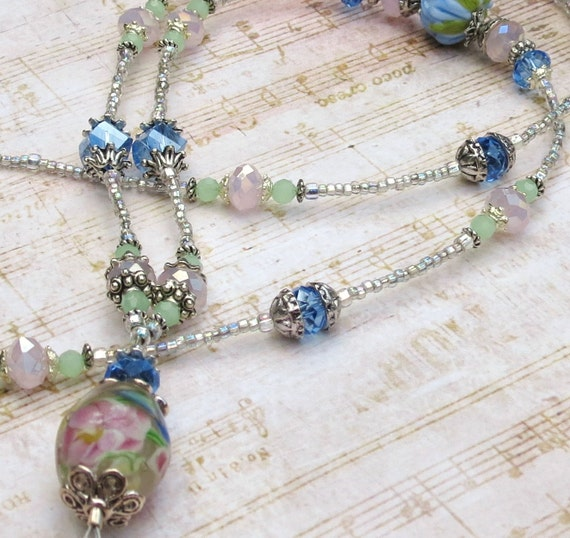 Blue, pink, and green floral lampwork and crystal beaded lanyard
