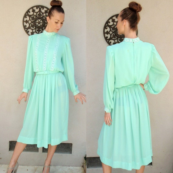 Long mint long sleeved belted dress with lace