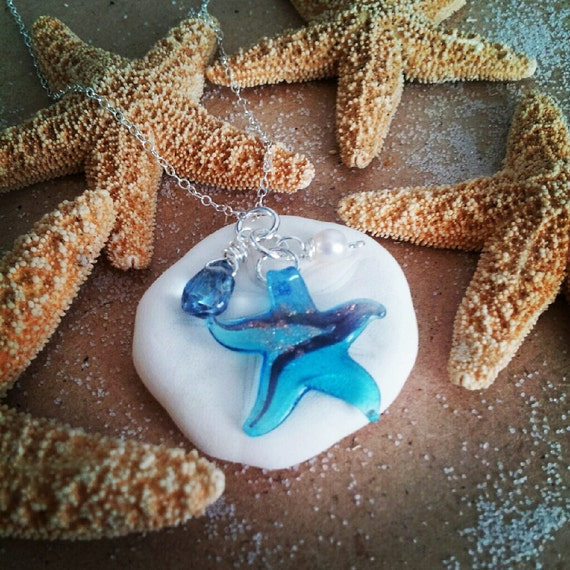 Ocean Inspired Hand blown Glass Starfish pendant on Silver chain with charms