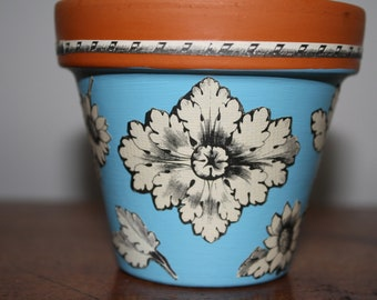 Decoupaged terra cotta pot paint washed with antique handcut English paper designs