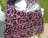 CLEARANCE - Vinyl Pocket Bib - Baby or Toddler-Sized - Black with Pink Scrolls/Curliques - Easy Clean