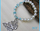 Ivroy and blue bracelet with a butterfly charm on it