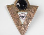 Vintage Brooch Eye painting Stamped Brass with Black stone
