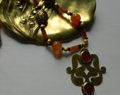 MOUCHARABIEH .Superb Turkmen goldwashed silver and carnelian pendant on matching necklace