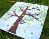 Wallhanging quilt with great tit (birds) on the tree