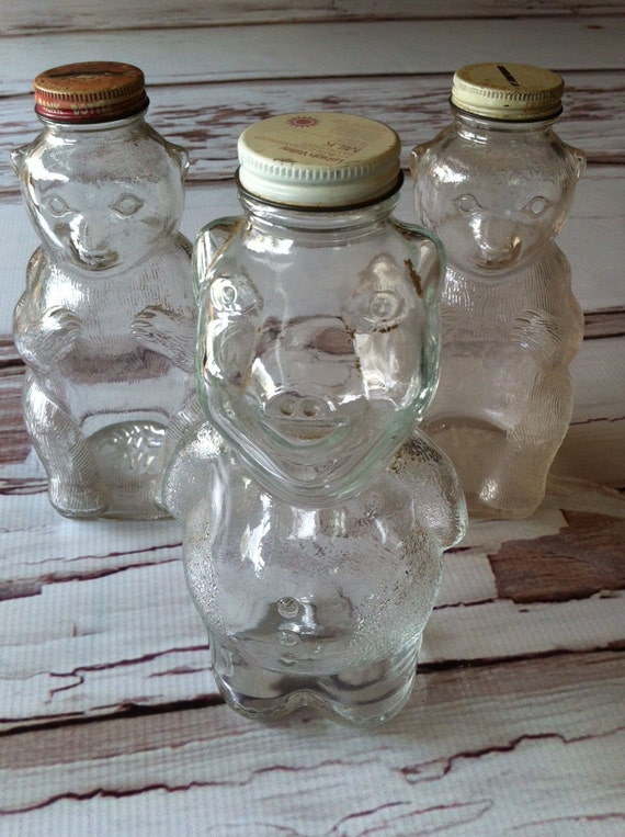 Very old glass honey bear and pig jars. Used for banks