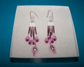 Pink and White Earrings with Shimmering Elegance. About 2.5 inches long, with latching silver hooks.