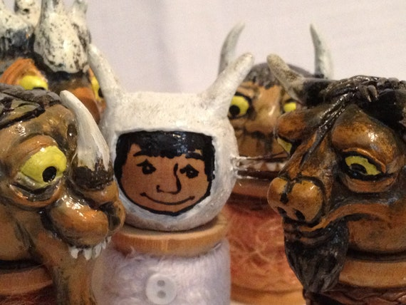 Set of 5 vintage spool dolls based off the book by Maurice Sendak, Where the Wild Things Are. Includes 4 hand sculpted monsters and 1 boy.
