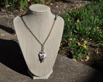 wire wrapped arrow head necklace: two tone with leather accent.