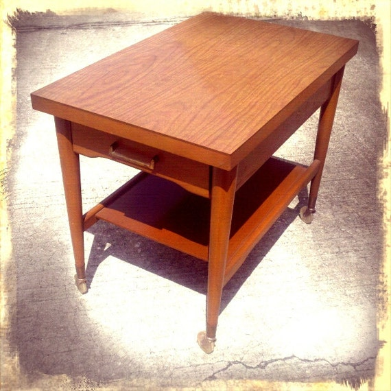 Mid century modern Danish style 60's Mersman rolling 2 tier end table with drawer.